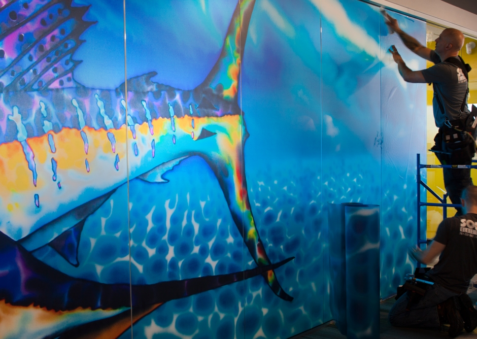 Jean-Baptiste Batik Silk Art reproduced into a glass wall art installation.
